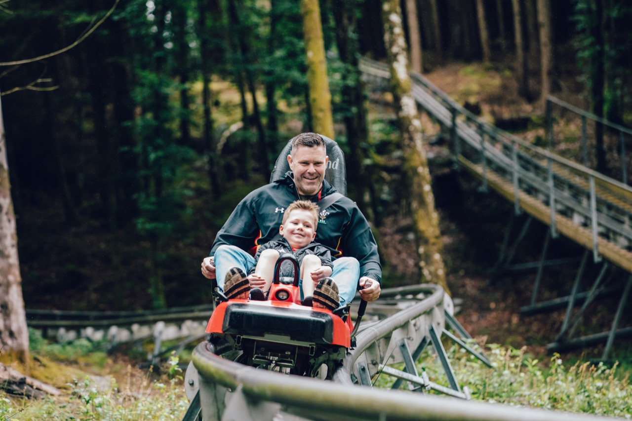 family enjoying the fforest coaster in north wales